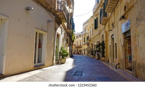 LECCE, ITALY - AUGUST 2, 2017: Charming street in old historic town of Lecce, Puglia, Italy