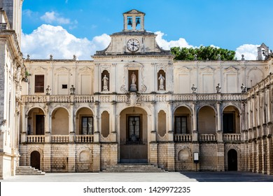 Lecce, Italy. July 28, 2015: Basilica Church of the Holy Cross. Lecce, Italy. Square of the famous basilica Church of the Holy Cross. Historic city of Lecce, Italy. Blue sky with some clouds.