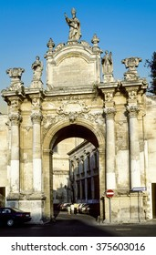 LECCE, ITALY - JUNE 30, 1995: people pass the famous Orontio gate in Lecce, Italy. Saint Orontius of Lecce is venerated as a saint by the Roman Catholic Church