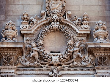 Lecce, Italy, October 2018: angelic cherubs and decorative stone carvings adorn the baroque façade of the Church of Santa Chiara in Lecce, a city in Puglia, Italy known as the Florence of the South.