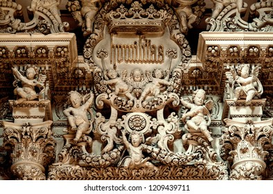 Lecce, Italy, October 2018: angelic cherubs and decorative stone carvings adorn the interior of one of Lecce many baroque churches. The famous city in Puglia is known as 'the Florence of the South'.