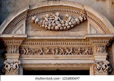 Lecce, Italy, October 2018: angelic cherubs and stone carvings of fruit adorn the exterior of Lecce's church of Santa Chiara. Lecce, 'the Florence of the South', is famous for its baroque architecture