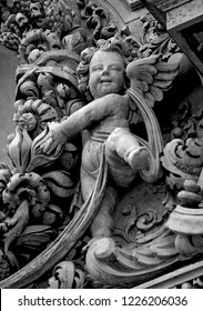 Lecce, Italy, October 2018: an angelic cherub and decorative stone carvings adorn the façade of the Church of Santa Chiara in Lecce, a city in Puglia, Italy known as the Florence of the South.