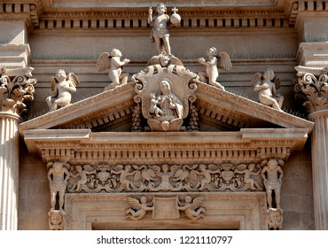 Lecce, Italy, October 2018: baroque carving of Jesus and the Virgin Mary surrounded by angels and cherubs adorning the exterior of one of Lecce's many baroque churches in Puglia, southern Italy .