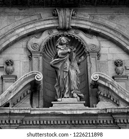 Lecce, Italy, October 2018: a baroque stone statue of St. Irene, patron saint of Lecce, adorns the exterior of the church of Santa Irene. The famous city is known as 'the Florence of the South'.