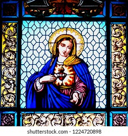 Lecce, Italy, October 2018: a stained glass window of the Virgin Mary with her sacred heart adorns the interior of one of Lecce many baroque churches in Puglia, southern Italy .