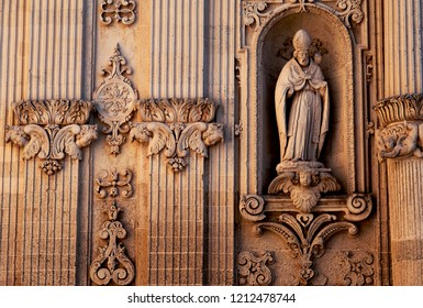 Lecce, Italy, October 2018: a statue of Saint Guisto on the facade of Lecce's imposing baroque cathedral. This Italian city, famed for its baroque architecture, is known as the Florence of the South.
