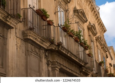Lecce, Italy. September 2018. Close up of baroque style building with and balcony in the town centre of Lecce, Puglia, Southern Italy.