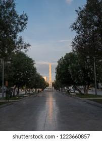 Lecce, Italy, September 2018. Obelisk close to Porta Napoli, historic gate to the city of Lecce in Puglia, Southern Italy.