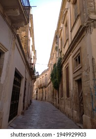 Lecce, Puglia, Italy - February 16, 2020: Facades of houses on Alami street in the historic center.
