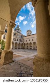 LECCE, Puglia ,Italy - March 08, 2019: Inside courtyard of university of Salento - UniSalento (Universita del Salento) and view to cupola of the church chiesa Maria ss.del Carmine. Apulia region