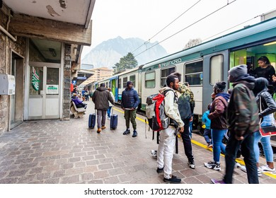 Lecco, Italy, February 16, 2020. Platform train station. Passengers get off the wagons