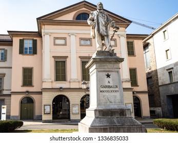 LECCO, ITALY - FEBRUARY 20, 2019: Monument to Giuseppe Garibaldi in front of Teatro della Societa (Theatre of Society) on square Piazza Giuseppe Garibaldi in Lecco city, Lombardy