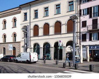 LECCO, ITALY - FEBRUARY 20, 2019: people near palace Palazzo delle Paure on street Lungolario Isonzo in Lecco city. Lecco is city in Lombardy, the capital of the province of Lecco