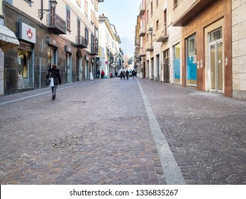 LECCO, ITALY - FEBRUARY 20, 2019: people walk along shops on street via Camillo Benso Conte di Cavour in Lecco city. Lecco is city in Lombardy, the capital of the province of Lecco