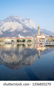 LECCO, ITALY - FEBRUARY 20, 2019: Lecco city on coast of Lario Como Lake with mount Monte San Martino. Lecco is city in Lombardy, the capital of the province of Lecco