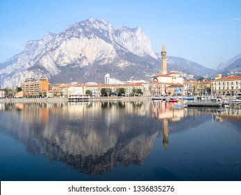 LECCO, ITALY - FEBRUARY 20, 2019: view of Lecco city on shore of Lario Como Lake with mount Monte San Martino. Lecco is city in Lombardy, the capital of the province of Lecco