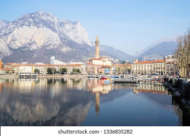 LECCO, ITALY - FEBRUARY 20, 2019: panorama of Lecco city on shore of Lario Como Lake with mount Monte San Martino. Lecco is city in Lombardy, the capital of the province of Lecco