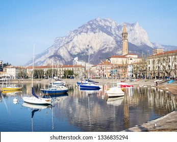 LECCO, ITALY - FEBRUARY 20, 2019: yacht mooring near waterfront at Lungolario Isonzo of Lario Como Lake in Lecco city. Lecco is city in Lombardy, the capital of the province of Lecco