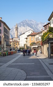 LECCO, ITALY - FEBRUARY 20, 2019: people walk on square Piazza XX Settembre in Lecco city. Lecco is city in Lombardy, the capital of the province of Lecco