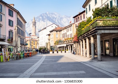 LECCO, ITALY - FEBRUARY 20, 2019: tourists on square Piazza XX Settembre in Lecco city. Lecco is city in Lombardy, the capital of the province of Lecco