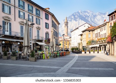 LECCO, ITALY - FEBRUARY 20, 2019: people in outdoor cafe on square Piazza XX Settembre in Lecco city. Lecco is city in Lombardy, the capital of the province of Lecco