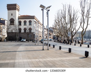 LECCO, ITALY - FEBRUARY 20, 2019: people on square Piazza Mario Cermenati near palace Palazzo delle Paure in Lecco city. Lecco is city in Lombardy, the capital of the province of Lecco