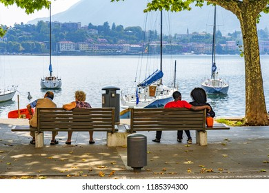 Lecco, Italy - July 13, 2018: Lecco, Italy - July 13, 2018: People waching panorama in Lecco at Como lake, Italy