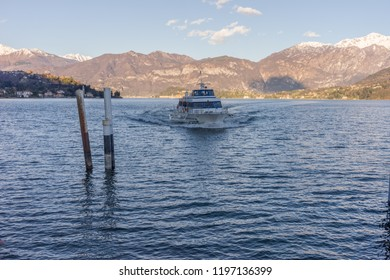 Lecco, Italy-April 1, 2018: Boat arriving at station at Lecco, Lombardy