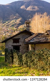 Lecco, Italy-April 1, 2018: Quaint house with mountain background at Lecco, Lombardy