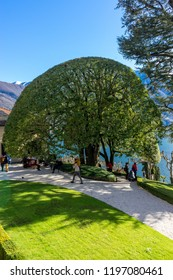 Lecco, Italy-April 1, 2018: Scenic tree garden overlooking Lake Como in the famous Villa del Balbianello at Lecco, Lombardy