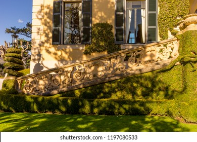 Lecco, Italy-April 1, 2018: Stairs with creeper decoration in the famous Villa del Balbianello at Lecco, Lombardy