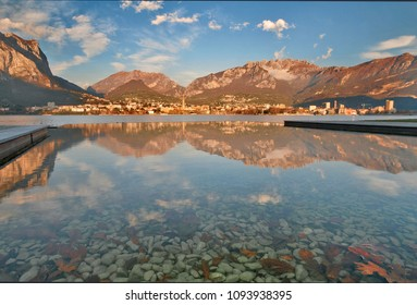 Lecco reflected on the lakefront of malgrate, Lecco province, Lombardy, italy
