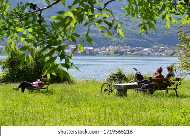 Lecco/Italy - May 23, 2013: People in holidays at the Lecco city lakefront in a sunny spring day.