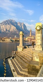 Lecco,Lombardy,Italy-02 September 2018: Here we see some people making photographs in front of the city of Lecco