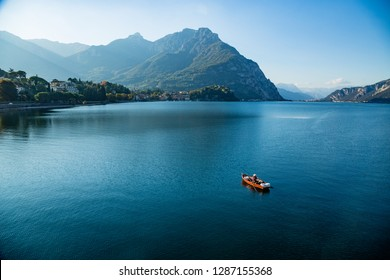 Lecco,Lombardy,Italy-09 october 2017: A lone fisherman on his boat on Lake Como near Lecco