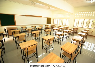 Lecture room or School empty classroom with desks and chair iron wood in high school thailand, interior of secondary education, vintage tone educational concept