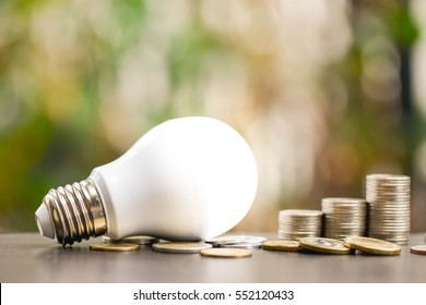 LED Bulb and Coin stack - Saving concept