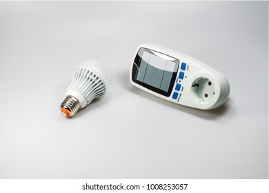 LED bulb and a consumption meter on a white background