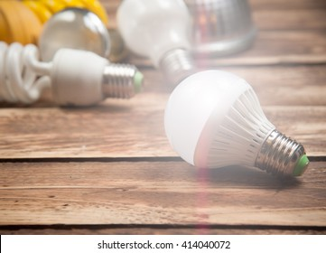LED bulb and Incandescent bulbs on the wooden,Light Effect
