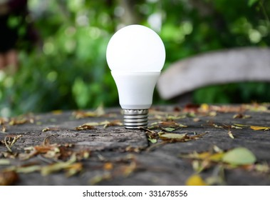 LED Bulb with lighting on nature background