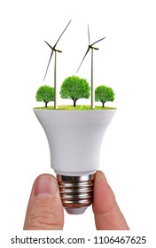 LED bulb with wind turbines in hand isolated on white background. Green energy concept.