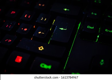 Led colored keyboard close up shot.Back lighted computer gaming keyboard with versatile color schemes.