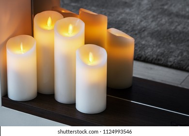 led electric candles stand in the home fireplace