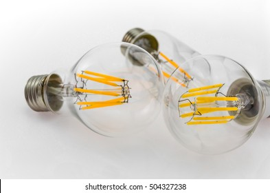 LED filament light bulbs produces light that is shaped to look like the filament of an incandescent light bulb
