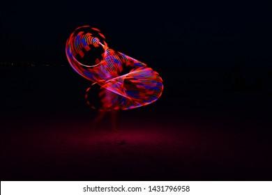 led hula hoop girl at night
