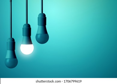 The LED lamp is illuminated and the other bulbs do not glow on a deep blue background.