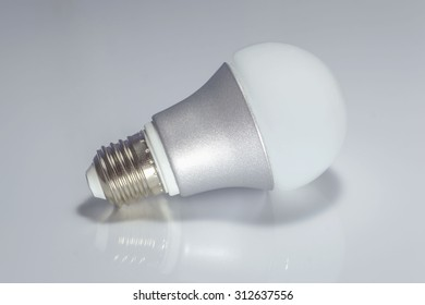 LED lamp on isolated gray background, ECO energy concept
