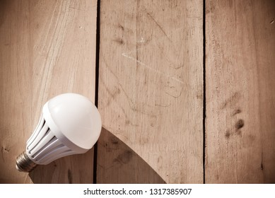 Led lamp on wooden floor