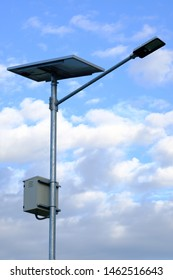 led light and solar cell panel on pole for saving energy have blue sky and clound background.